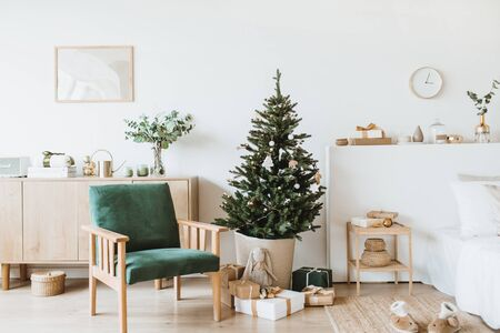 Foto de Modern interior design living room with Christmas / New Year decorations, toys, gifts, fir tree. Winter holidays composition. - Imagen libre de derechos