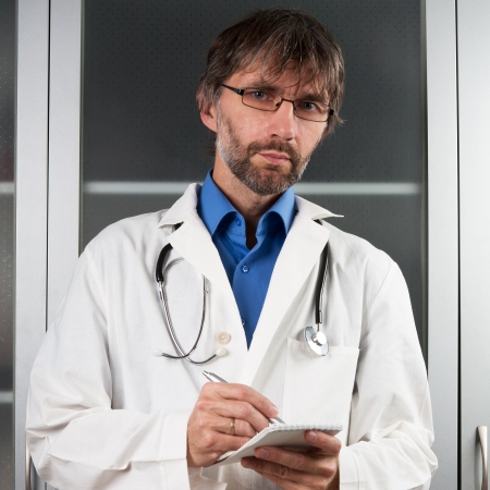 doctor writes in a notebook to the clinic