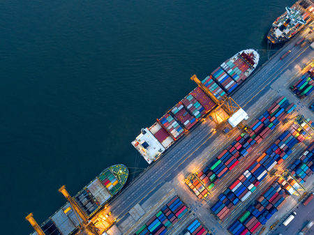 Foto de Aerial view of business port with shore crane loading container in container ship in import/export and business logistics with crane and shipping cargo.International transportation concept.  - Imagen libre de derechos