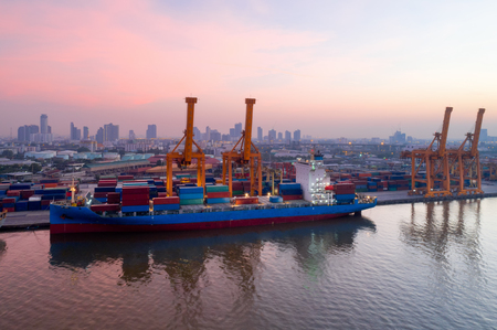 Photo for Aerial view of Containers yard in port congestion with ship vessels are loading and discharging operations of the transportation in international port.Shot from drone. - Royalty Free Image