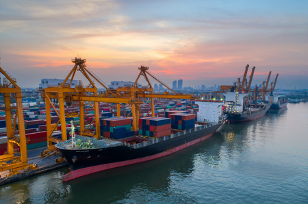 Photo for Containers yard in port congestion with ship vessels are loading and discharging operations of the transportation in international port.Shot from drone. - Royalty Free Image