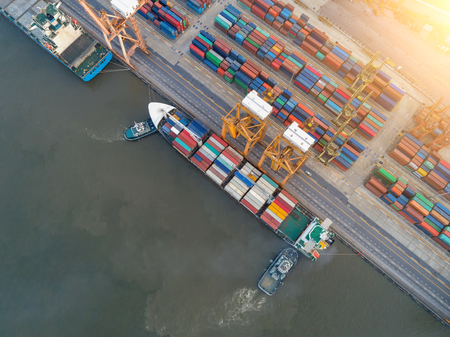 Foto per Aerial view of business port with shore crane loading container in container ship in import/export and business logistics with crane and shipping cargo.International transportation and business concept.  - Immagine Royalty Free