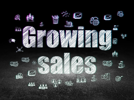 Business concept: Glowing text Growing Sales,  Hand Drawn Business Icons in grunge dark room with Dirty Floor, black background