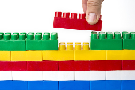 Foto de Lego wall. Creativity unity and fit or doesn't fit concept - Imagen libre de derechos