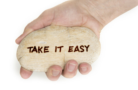 Photo pour Pebble stone in hands. Concept for  take it easy sign - image libre de droit