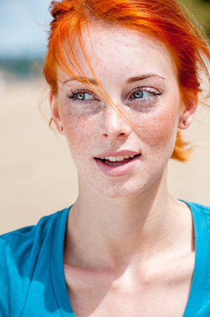 Photo for Closeup outdoor portrait of a young beautiful redhead freckled woman thinking about something - Royalty Free Image