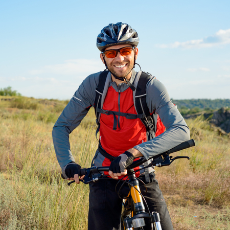 Foto de Portrait of Young Cyclist in Helmet and Glasses. Sport Lifestyle Concept. - Imagen libre de derechos