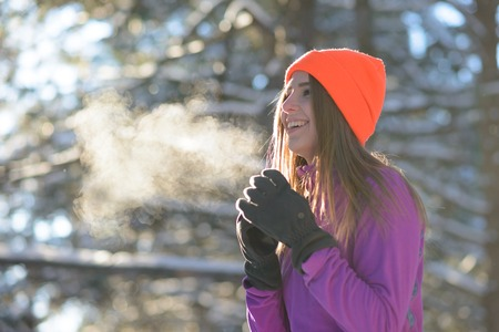 Photo pour Young Woman Runner Smiling in Beautiful Winter Forest at Sunny Frosty Day. Active Lifestyle and Sport Concept. - image libre de droit