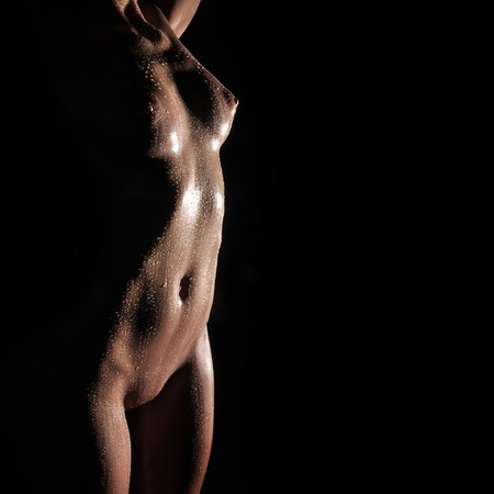 Photo pour Chest and belly naked on a black background - image libre de droit