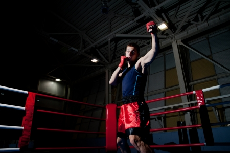 Young adult man boxing in gym