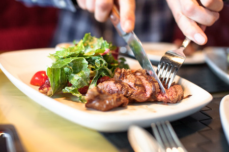 Photo for man eating meat with salad - Royalty Free Image