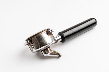 Foto de Coffee barista scoop or spoon machine full of ground coffee isolated - Imagen libre de derechos