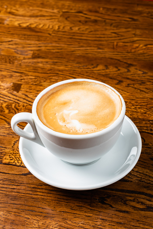 Photo pour Cup of cappuccino - image libre de droit
