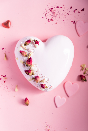 Photo for Cake with berries in the shape of heart on Valentine's Day - Royalty Free Image