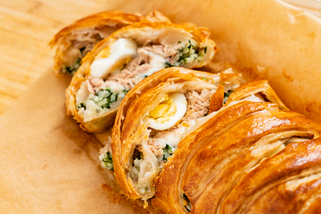 Photo for Spinach pie: Italian stromboli with eggs, spinach and mozzarella (Easter pastry) - Royalty Free Image