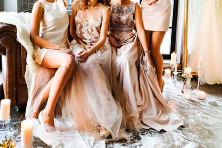 Photo for Bride and bridesmaids on the sofa - Royalty Free Image