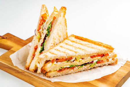 Photo for Sandwich with ham, cheese, tomatoes, lettuce, and toasted bread. - Royalty Free Image