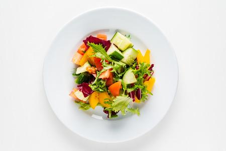 Foto de vegetable salad on the white plate - Imagen libre de derechos