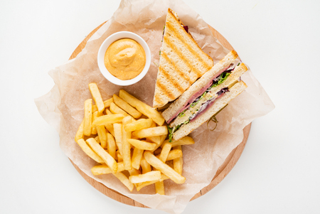 Photo for Club Sandwich with Cheese, PIckled Cucmber, Tomato and Smoked Meat. Garnished with French Fries - Royalty Free Image