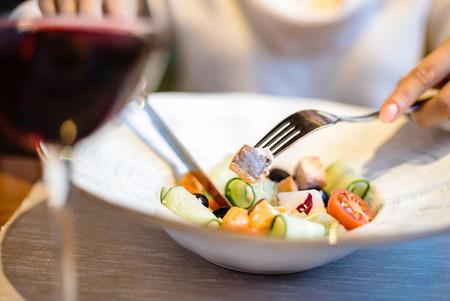 Foto de woman eating green healthy greek salad - Imagen libre de derechos