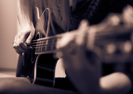 Photo for Rockman Guitar Player > Musician playing a guitar, feminine hands - Royalty Free Image