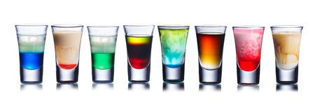 Foto de Collection of alcoholic cocktails in shot glasses. Shots. Colorful shot drinks - Imagen libre de derechos