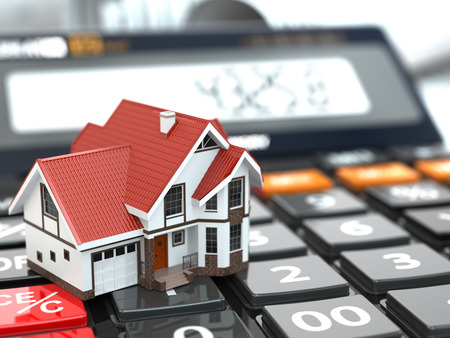Photo for Real estate concept. House on calculator. Mortgage. 3d - Royalty Free Image