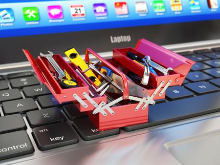 Foto de Laptop and toolbox with tools. Online support. 3d - Imagen libre de derechos