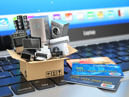 Photo for E-commerce or online shopping or delivery concept. Home appliance in box with credit cards on the laptop keyboard. 3d - Royalty Free Image