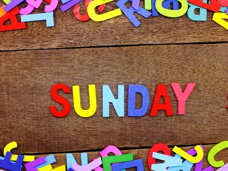 Foto per colorful wooden alphabet sunday spelling on wooden background - Immagine Royalty Free