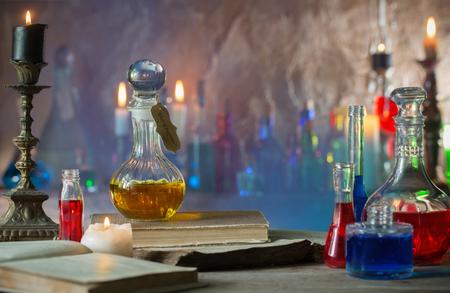 Foto de Magic potion, ancient books and candles - Imagen libre de derechos