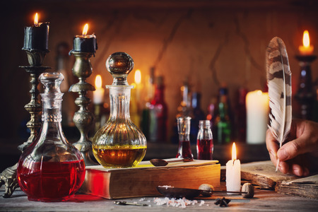 Foto de Magic potion, ancient books and candles - Imagen libre de derechos