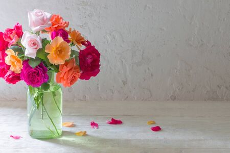 Foto de roses in vase on background white wall - Imagen libre de derechos