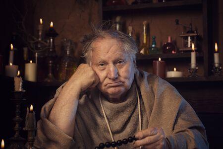 Foto de elderly alchemist monk with rosary - Imagen libre de derechos