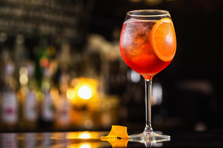 Photo for Closeup glass of spritz aperol cocktail decorated with orange at bright bar counter background. - Royalty Free Image