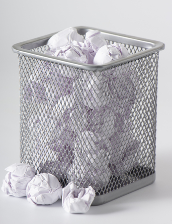 Photo for A trashcan full of crumpled paper on white background - Royalty Free Image