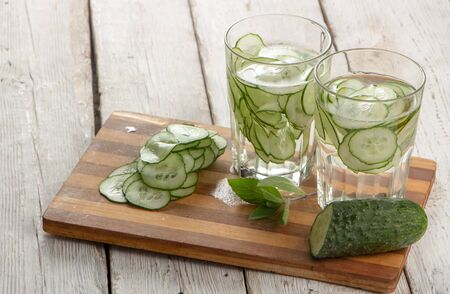 Foto de Cucumber water, cleansing water to detoxify the body and quench thirst on a white background. close-up - Imagen libre de derechos