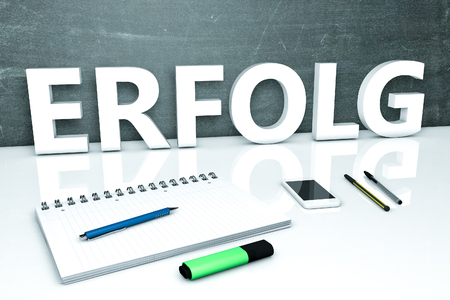 Erfolg - german word for success - text concept with chalkboard, notebook, pens and mobile phone. 3D render illustration.