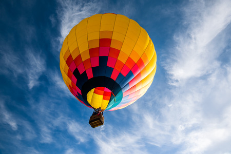 Photo for Hot air balloon against dark cloudy sky. - Royalty Free Image