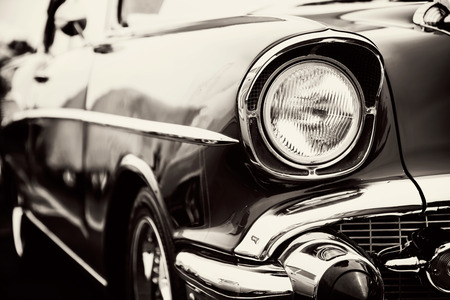 Photo pour Classic car with close-up on headlights - image libre de droit