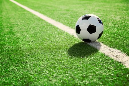Photo pour Soccer ball on soccer field - image libre de droit