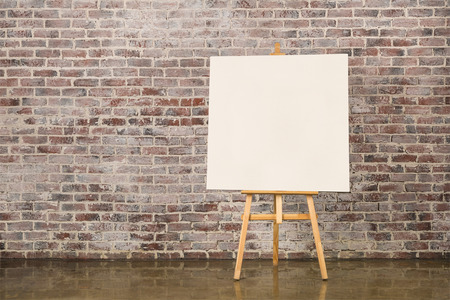 Photo for Easel with blank canvas on a brick wall background - Royalty Free Image