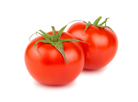 Photo pour Two red ripe tomato isolated on white background - image libre de droit