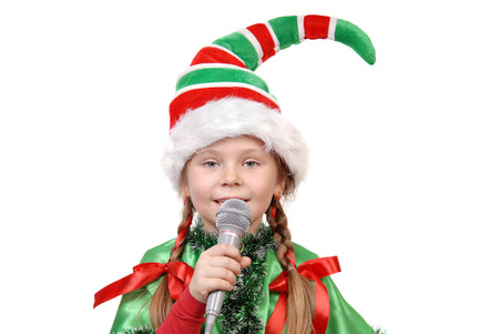 Girl in suit of Christmas elf isolated on a white