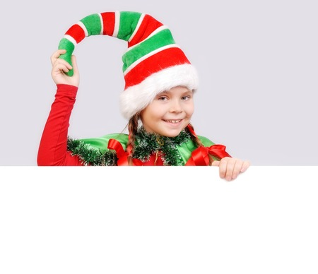 Photo for Girl Santas elf with the white banner. - Royalty Free Image