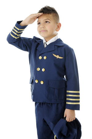 Photo for A handsome elementary airline pilot saluting with his hat to his side and right hand at his forehead.  On a white background. - Royalty Free Image