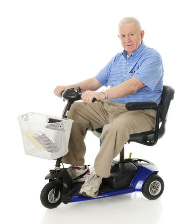 Foto de A senior man smiling at the viewer as he's ready to drive away on his scooter.  On a white background - Imagen libre de derechos