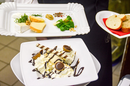 Photo for Everyday work in the restaurant. Decorated desserts are brought to the guest - Royalty Free Image