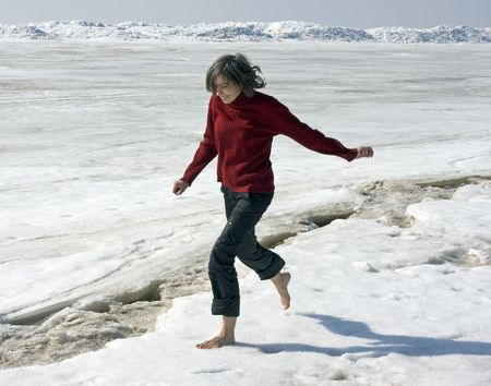 girl running barefoot on snow