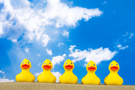 Photo for Rubber ducks on beach - Royalty Free Image